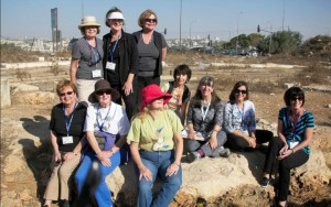 Here we are – a group of Marys, Maries, Marias, Mary Janes… and one Miriam – everyone in our group with a version of the famous name, invited to sit on the rock for a photo to commemorate our visit. Photo: Dr. Bill Creasy