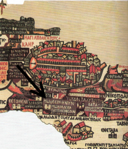 "Portion of the Madaba Map. Below the walled city of Jerusalem, the arrow I've inserted points to the Greek words: MOΔΕΕΙΜ · Η ΝΥΝ ΜWΔΙΘΑ ˙ ΕΚ ΤΑΥΤΗC HCAN OI MAKKABAAIOI (""Modi'in, which is today Moditha; home of the Maccabees"")."
