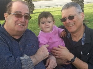 The youngest Dubinsky (to date...) flanked by her grandpas, Arik Vamosh, left, and Roni Dubinsky, right