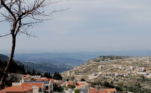 Canaanite city of Hakfira (at top left of hill in center) with Qatanah on the slope and the Ayalon Valley in the distance. In the foreground: Har Adar. Photo: Miriam Feinberg Vamosh
